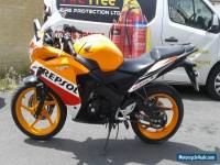 2011 HONDA CBR 125 RW-B REPSOL INC PRIVATE PLATE READS EMEGO PLZ READ AD