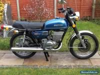 Suzuki motorcycle gt 250 ram air.
