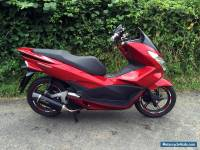 2015 Honda PCX 125cc Scooter in Red with Leo Vince Exhaust and other extras.