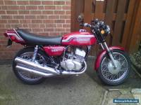 KAWASAKI 350cc S2 IN PEARL CANDY RED RECENT RESTORATION